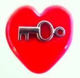 Impressed Brass KEY on Red Glass Heart Shaped Button